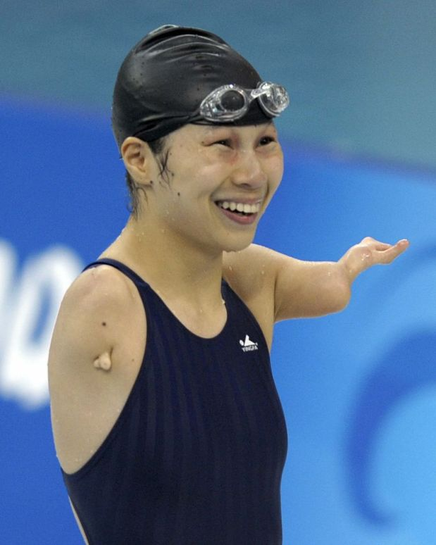 Jiang Fuying of China smiles after winning the women's 100m butterfly S6 final during the 2008 Beijing Paralympic Games at the National Aquatics Center in Beijing on September 13, 2008. Jiang Fuying won with a new world record of 38.44. AFP PHOTO/LIU Jin